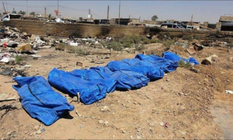 Photo of Shyetat massacre victims buried in mass grave in Deir Ezzur, Syria