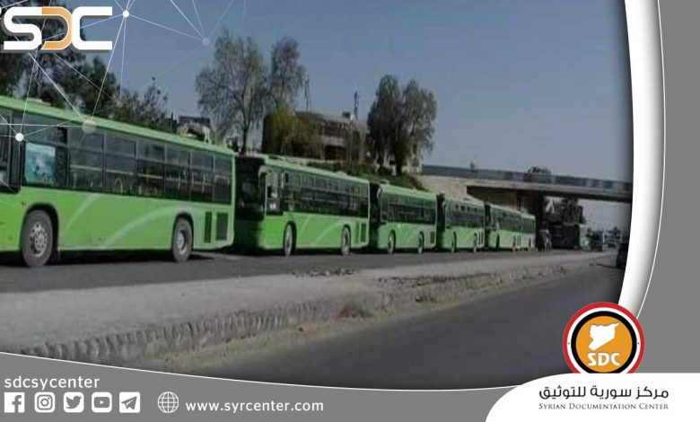 Buses arrive on the outskirts of Daraa Al-Balad after an agreement under the auspices of Russia.